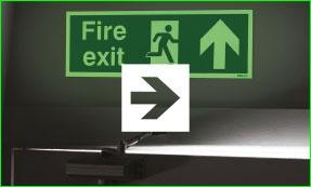 Photoluminescent forward arrow fire exit sign with arrow icon