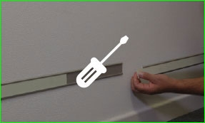 Putting glow in the dark tape onto the wall, screwdriver icon